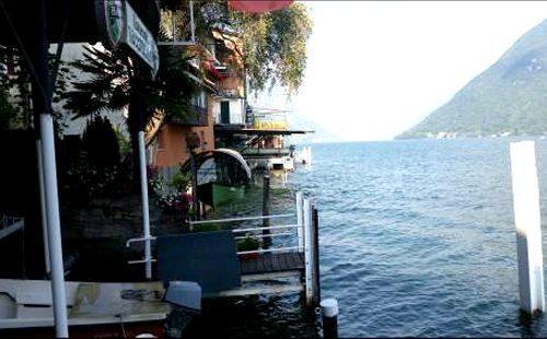 romantica veduta del lago di lugano a pochi minuti dai nostri appartamenti in affitto